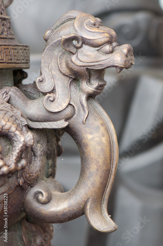 lion statue on joss stick pot