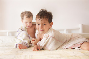 two kids after having bath
