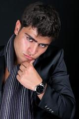 Elegant young handsome man,  intense gaze