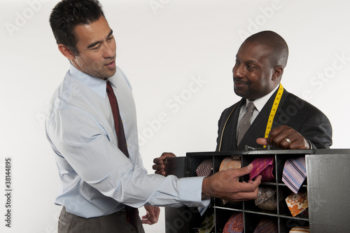 Man selecting necktie