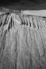 Abstract texture of sand in Black and white. Grainy film look.