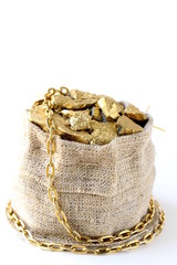 gold nuggets on a small pouch