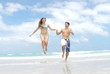 Young happy couple in love at the beach - slow motion