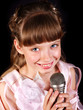 Singing of child in microphone.