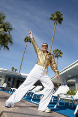 Low angle view of man impersonating Elvis Presley