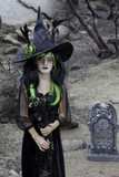 Portrait of young girl costumed as a witch