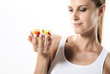 Fit young woman eating fruit salad