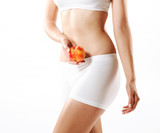 Fit young woman holding a peach