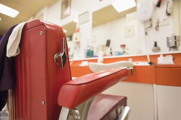 Empty chair in barbershop
