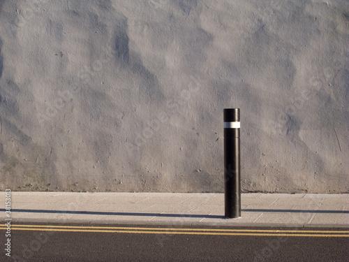 Wall, post, pavement.