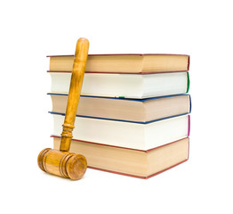 books and gavel on white background