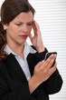 businesswoman receiving bad news on her cell