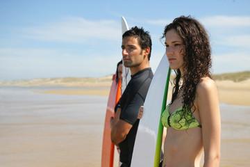 Surfers staring at the horizon