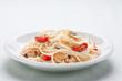 Tagliatelle sautéed with tomatoes and mushrooms