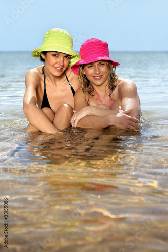 two girlfriends bathing in the sea