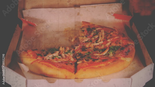 Vintage film. Hands of the people take to pizza.