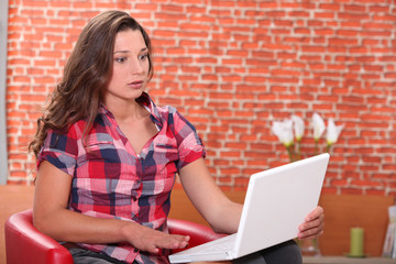 Shocked woman in front of laptop