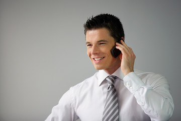 Happy executive on the phone