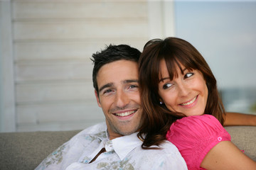 Cheerful couple sitting on a sofa