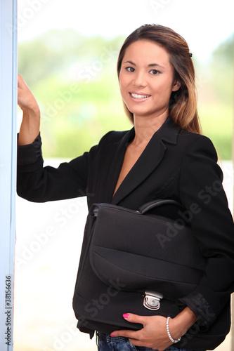 Woman opening her front door