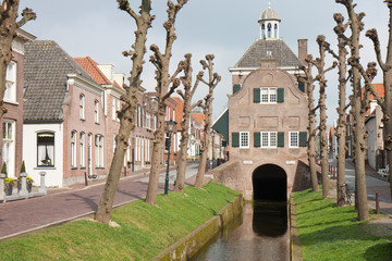 Old town hall of the Dutch city Nieuwpoort, built over a channel