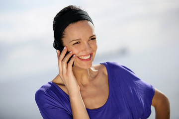 Smiling woman using a phone
