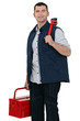 Casual worker carrying wrench and tool box