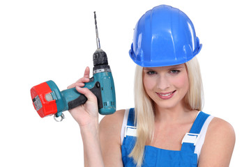 beautiful platinum blonde holding electric drill