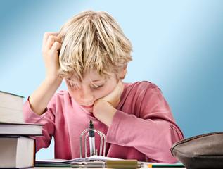 focused boy doing his homework