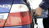 Man filling up a vechicle with fuel; Full HD hoto JPEG