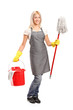 Full length portrait of a female cleaner holding a bucket with c