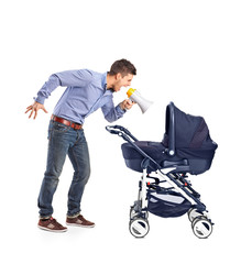A mad father yelling to his baby laid down in a baby carriage