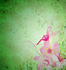 pink little flower fairy on the green spring or summer grunge ba