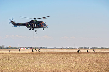 Helicopter and soldiers in action
