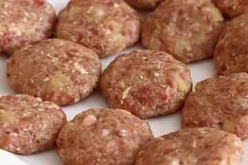 Food, uncooked italian meatballs