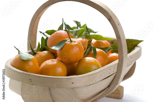 wooden trug of clementine oranges