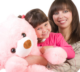 mother and her little daughter embracing with pink bear