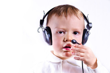 young boy wearing telephone headset