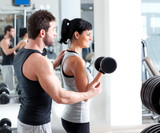 Fototapety gym woman personal trainer with weight training