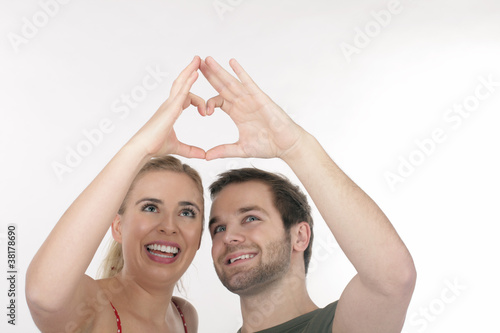 A happy couple showing the heart