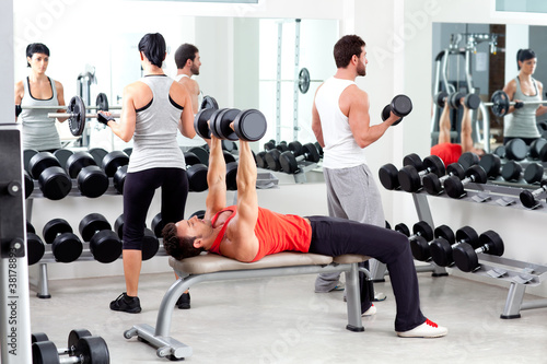 group of people in sport fitness gym weight training