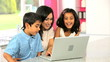 Attractive Asian Mother & Children Using Laptop