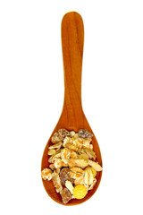 cereal muesli on wooden spoon isolated