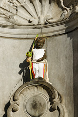 Manneken Pis statue in Brussels with dress.