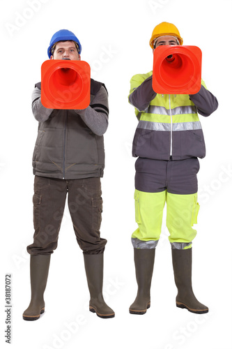 Tradesmen using pylons as megaphones