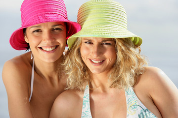 Two women wearing bikinis and hats