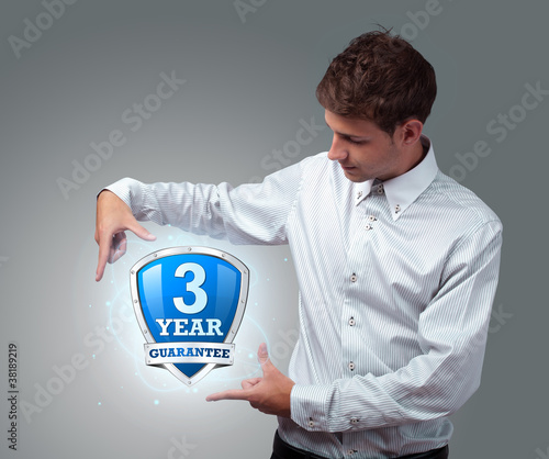 businessman holding virtual shield sign