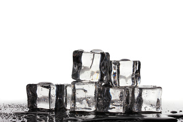 Melting ice cubes isolated on white