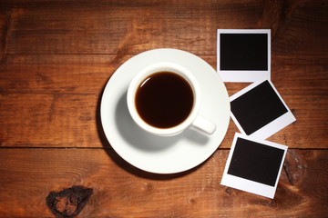 Photo papers with coffee on wooden background