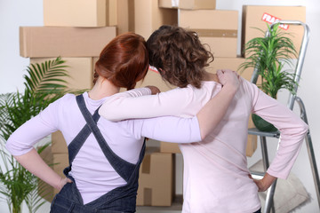 young women moving into a new flat